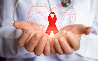 Giornata mondiale contro l'AIDS: 3 spunti per chiarirsi le idee. Ribbon for the fight against aids in the hands of the doctor.